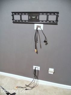 Decorating Cents: Wall Mounted TV and Hiding The Cords #tvwallmountmodern