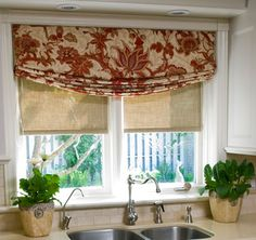 Beautiful relaxed roman shades in a kitchen window adds for Fabric shades for kitchen windows