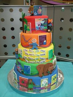 AMAZING cake featuring many of my favorite children's books...maybe I could do a styrofoam cake with Velcro to change out the books