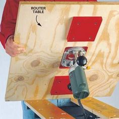 portable router table that is using home woodworking bench: