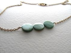 Teal circle shell beads on antiqued gold by MySoCalledVintage, $22.00
