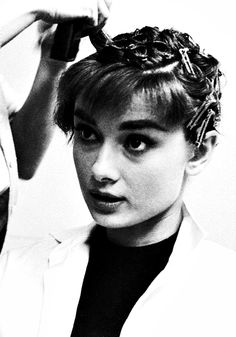 Audrey gets her hair done on the set of Sabrina, photographed by Mark Shaw in 1953
