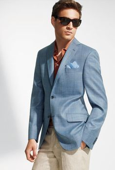 What is the difference between a blazer and a sports coat? A blazer is always a solid color and is constructed much like a suit coat.  A sport coat always has some type of pattern, whether it be stripes, checks, or herringbone and can have a softer shoulder then a suit coat or blazer. A sports coat does not require a tie and can be layered with other pieces like a sweater or sweater vest. A sports coat can define it's own sense of style and can set the tone for men's clothing at it's best.