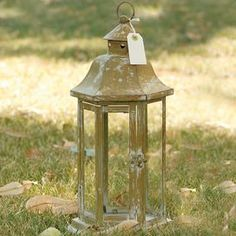 Distressed lantern.  Product: LanternConstruction Material: Metal and glassColor: Distressed beigeAccommodates: (1) Candle - not included