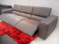 Binari contemporary recliner sofa. This size is a 3 seater 78cm. Total length 290cm. It is shown with all three seats reclined and with the headreasts up. Made in grey leather. As shown at Grand Designs London 2014.