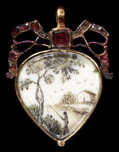Locket, gold with openwork set with garnets enclosing a painting on ivory incorporating hair, the back set with agate, England, circa 1750
