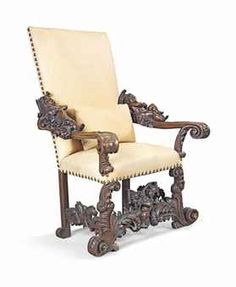 AN ITALIAN CARVED WALNUT ARMCHAIR - IN THE MANNER OF ANDREA BRUSTOLON, LATE 19TH CENTURY - The padded back and sprung seat covered with close-nailed yellow leather, flanked by out-scrolled arms headed by reclining putti over a scrolled base, the front legs joined by a stretcher with a further putto 51 ¼ in. (130 cm.) high; 37 ¾ in. (96 cm.) wide; 33 ½ in. (85 cm.) deep