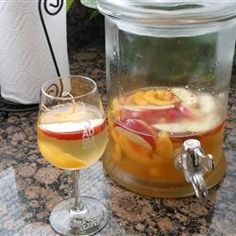 "White Peach Sangria | ""This is the BEST sangria I've ever had!!!! I used sliced frozen peaches and added peach mango seltzer. Served at a picnic on a warm day and everyone asked for the recipe!"""
