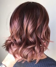 Bronzed Gold Curls - Rose Gold Hair Ideas That'll Have You Dye-Ing For This Magical Color - Photos