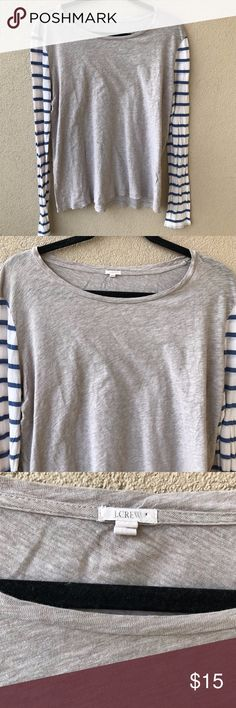 """J. Crew Vintage Style Striped Baseball Tee Long sleeve vintage style baseball t-shirt from J.Crew.  This blouse has a scoop neck, a beige / tan body, and white and blue striped sleeves.  Gently used condition except small holes on bottom front AND on underarms.  - Size Large L - Approx. 22"""" armpit to armpit - Approx. 25"""" long - JCREW Style # 48460 - Closet ID # 0306 J. Crew Tops Tees - Short Sleeve"""