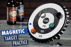 Magnetic bullseye target catches bottle caps Integrated kickstand Includes six unlabeled bottle caps Shaped like a giant bottle cap Materials: Textured plastic