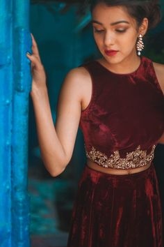 The royal velvets collection is filled with red and black velvet tops and skirts. Skirt Blouse Design, Blouse Designs, Indian Skirt, Indian Blouse, Ethnic Crop Top, Kerala Engagement Dress, Velvet Tops, Red Velvet, Ethnic Outfits