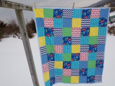 "Though you may not know it with the snow clouds and 18"" of snow on the ground, this is a bright, ocean fabric summer weight quilt with minky dot back. Made by Janice Bailor, La Rue de Fleurs."
