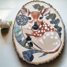 Finished this little fawn late last night. Prismacolor pencil ink and brass studs (in center of flowers) on wood. by wildairco