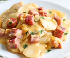 Cheesy Scalloped Potatoes with Ham Thinly sliced potatoes and diced ham smothered in a creamy, super cheesy sauce and baked to perfection! Get the recipe at Pork Recipes, Cooking Recipes, Potato Recipes, Veggie Recipes, Dessert Recipes, Scalloped Potatoes And Ham, Cheesy Potatoes, Leftover Ham Recipes, Potato Side Dishes