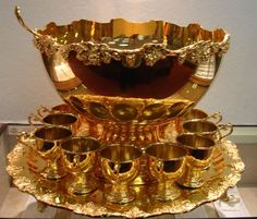 """24kt Gold Plated Punch Bowl Set; tray 21"""" diameter, bowl 16"""" diameter and 12 1/2"""" high; 12 cups and ladle."""