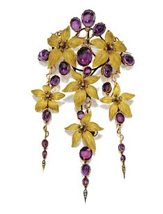 GOLD, AMETHYST AND DIAMOND CORSAGE ORNAMENT, CIRCA 1870.  Supporting three trailing fringes, composed of six yellow gold flowerheads with centers of rose-cut diamonds and oval cabochon amethysts in closed-back settings on rose gold curling vines, further accented with small rose-cut diamonds, French import mark, brooch fitting detachable. With leather case.