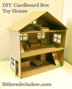 DIY Cardboard Box Doll House | http://littleredwindow.com | Make a sweet toy doll house from a recycled cardboard box!