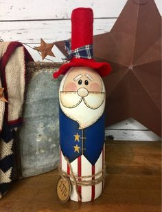 What a firecracker is this little dude? This meticulously painted Uncle Sam wine bottle decoration is a happy way to display your patriotic pride for memorial day, Independence Day, and every day! Liquor Bottle Crafts, Glass Bottle Crafts, Wine Bottle Art, Painted Wine Bottles, Painted Jars, Lighted Wine Bottles, Hand Painted, Beer Bottle, Decorated Bottles