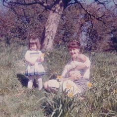 """writemeanna: """" Sylvia Plath with her children, Frieda and Nicholas Hughes, among the daffodils at Court Green, early April 1962 """" Nicholas Hughes, Sylvia Plath, People Of Interest, American Poets, John Keats, History Of Photography, Edgar Allan Poe, Illustrations, Daffodils"""