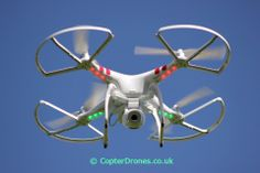The Phantom 2 Vision in a hover with its position stable and fixed thanks to the GPS Dji Phantom 2, Aerial Photography, Drones