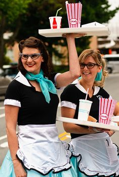 Car Hop Girls: Cat-eye glasses, high ponies and neck scarves? Yes, please! Don't let those roller skates gather dust and enjoy a chocolate malt while you're making your costume to get into character. (via Flirk user thaths)