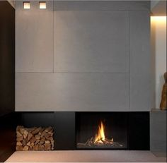A modern architecture gas fireplace. Small Fireplace, Concrete Fireplace, Home Fireplace, Living Room With Fireplace, Fireplace Surrounds, Fireplace Design, Fireplace Hearth, Modern Interior, Interior Architecture
