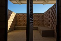 urbanika utlizes rough brick pattern for community boxing gym in chihuahua, mexico