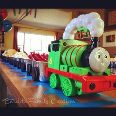 Thomas the Train Birthday Party idea -- freight cars are loaf tins with oreos as the wheels. Could fill with candies and let kids make their own treat bags. Percy flash light at the front. Pretty sure they have a Thomas. by carolyn