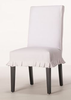 Affinity Slipcover - love this!  Isn't overpowering by dropping to the floor.  WHITE with farm table and black base.
