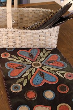 Wooly table runner by R. L. Smith. This will be at the American Heritage craft show this weekend along with other great pieces! #folkart #wool https://www.facebook.com/AmericanHeritageCraftsmenArtisanShow