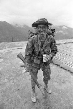 VIETNAM - 1973: U.S. Army soldier Corporal Cooley (holding a Pepsi soda can) of the 101st Airborne Division in the mountains above Hue, Vietnam 1973. Cooley was a member of a Recon outfit. (Photo by David Hume Kennerly/Getty Images)