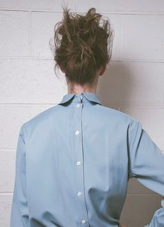 buttons up the back + messy bun.