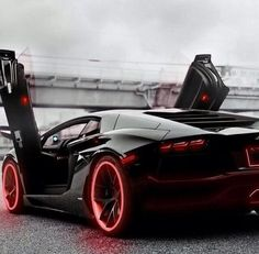 Red & Black Lamborghini. Love the Neon on the tires!! This would be so sick.