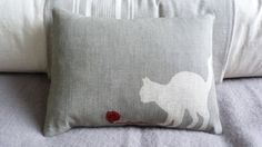 hand printed muted grey cat cushion with little wool ball £42.00