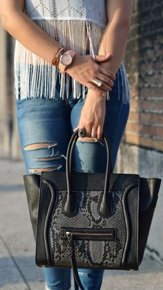 Cece bag and riped jeans with a fringe top. www.amoreff.com