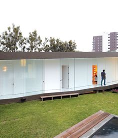 At once part of the city and protected from it, the house benefits from plenty of open space and light and creates its own courtyard encl...