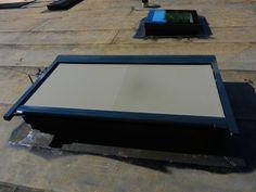 Buitenzonwering op een SkyVision daklicht voor vlakke daken.
