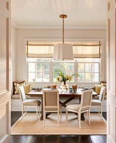 kitchen / breakfast area inspiration - tongue and groove ceiling, roman shade, banquette