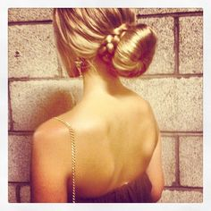 Sock bun wrapped with braid- would be cute with a french braid on the side too