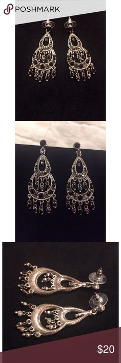 """Silver and Black Rhinestone Chandelier Earrings These gorgeous chandelier earrings are in perfect condition. The widest part of the smaller circular area on top is  approx. 5"""" with the bottom part being approx. .75"""". From top to bottom in length they're just under 2.5"""". Plastic protector backs as well. Jewelry Earrings"""