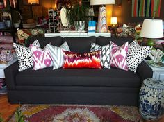 Love all the bright pillows on the charcoal sofa. These are inexpensive fabrics that make a fun and whimsical look. Charcoal Couch, Charcoal Gray, Neutral Couch, Gray Sofa, Interior Design Inspiration, Room Inspiration, Pillow Room, Couch Pillows, Cushions