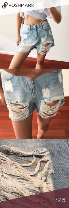 """Distressed Relaxed Fit Denim Shorts Faded, frayed, and distressed in all the right places, these love-worn denim cutoffs will be perfect for music festivals, streetwear, or BBQs this summer. A MUST-HAVE this season. Loose, relaxed fit. You'll be in love with these soft, comfy shorts  •15"""" across, 13"""" rise, 2"""" inseam, 100% cotton •Zip fly with button closure, five-pocket silhouette, belt loops, high-rise •Contrast stitching, silver-tone hardware  Modeling a size S My measurements- 5""""8, 24/25…"""