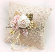 ***Ready To Ship   This magnificent Ring Bearer Pillow has been crafted in shades of ivory, champagne, gold and rose blush. The exquisite…