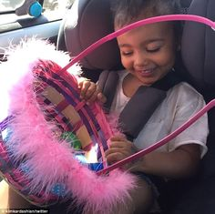 Nanny's little girl: North West, who was on the train journey with her dad and grandmother...