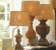 redo interesting old lamps I think these are pottery barn,  but you could antique paint thrift store lamps and add a burlap shade.