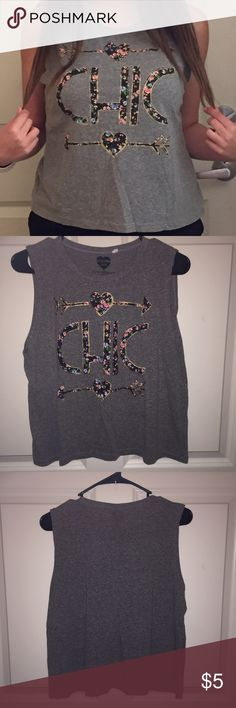 Graphic Muscle Tee Super cute and casual grey muscle tee! Super soft cotton material perfect for a casual outfit or workout too. Only worn once. Juniors size but would probably fit a medium in women's Tops Muscle Tees
