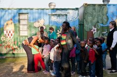 First Lady Michelle Obama greets children at the Zandspruit Township Daycare Center at…