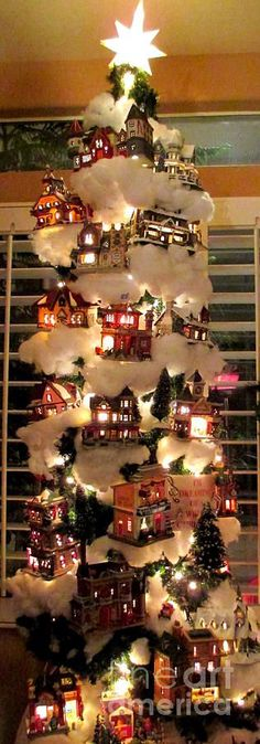 Topo thinks this Village Christmas Tree could be a useful tutorial to make at home out of all the winter house decorations, with lighted houses and string lights.