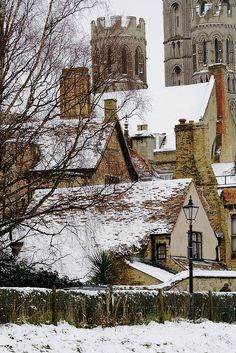 Snowy rooftops next to Ely Cathedral